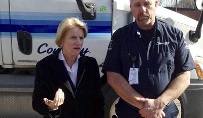 U.S. Rep. Shelley Moore Capito, R-W.Va., left, talks with Conway Freight driver Joe Stanley on Friday, March 7, 2014, in Winfield, W.Va. Stanley took Capito on a truck tour of a two-lane section of U.S. Route 35 in Putnam and Mason counties. Capito is looking at ways to get federal funding to help finish a project to widen the 14.6-mile section of highway to four lanes. (AP Photo/John Raby)