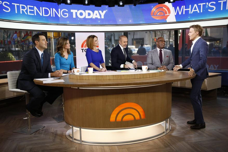 """This Feb. 24, 2014 photo released by NBC shows, from left, Carson Daly, Natalie Morales, Savannah Guthrie, Matt Lauer, Al Roker, and Ronan Farrow on """"Today,"""" in New York. After winning in the ratings for two weeks during the Winter Olympics _ NBC's first weekly wins since the London games in summer 2012 _ the """"Today"""" show has kept some of its momentum now that Matt Lauer, Savannah Guthrie and the team are back in the New York studio. (AP Photo/NBC, Peter Kramer)"""