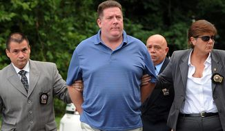 FILE - This Aug. 15, 2012 photo shows Raymond Roth, center, as he is escorted by law enforcement officers to the Long Island State Park Police Headquarters, in Babylon, N.Y.  Roth already facing prison time for faking his own drowning in an insurance fraud scheme was convicted Friday, March 7, 2014 of impersonating a police officer, but he was cleared of attempting to kidnap a woman authorities said he chased and tried to force into his van. (AP Photo/Kathy Kmonicek, File)