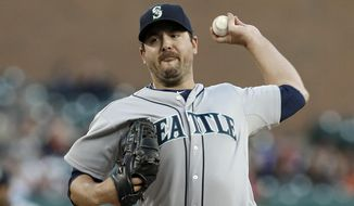 FILE - In this Sept. 16, 2013, file photo, Seattle Mariners pitcher Joe Saunders throws against the Detroit Tigers in a baseball game in Detroit. Saunders and the Texas Rangers have finalized a one-year contract that guarantees him the $500,000 minimum. (AP Photo/Paul Sancya, File)
