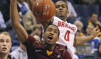 Bradley guard Ka'Darryl Bell, top, defends against a shot by Loyola of Chicago forward Christian Thomas during the first half of an NCAA college basketball game in the Missouri Valley Conference men's tournament, Thursday, March 6, 2014, in St. Louis. (AP Photo/St. Louis Post-Dispatch, Chris Lee) EDWARDSVILLE OUT  ALTON OUT