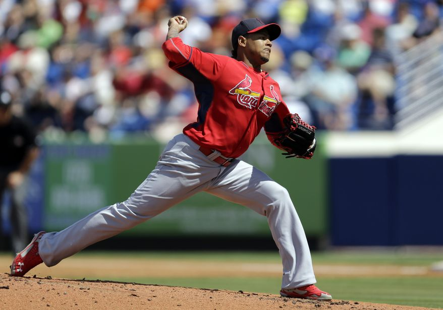 St. Louis Cardinals starting pitcher Carlos Martinez throws during the first inning of an exhibition spring training baseball game against the New York Mets Friday, March 7, 2014, in Port St. Lucie, Fla. (AP Photo/Jeff Roberson)