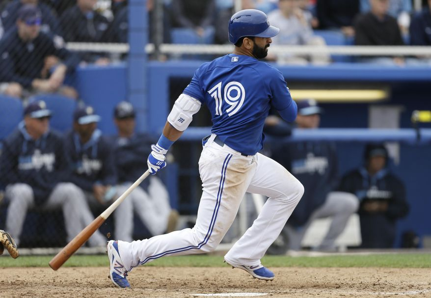 Toronto Blue Jays' Jose Bautista hits a single during the fifth inning of an exhibition baseball game against the Tampa Bay Rays Friday, March 7, 2014, in Dunedin, Fla. (AP Photo/Charlie Neibergall)