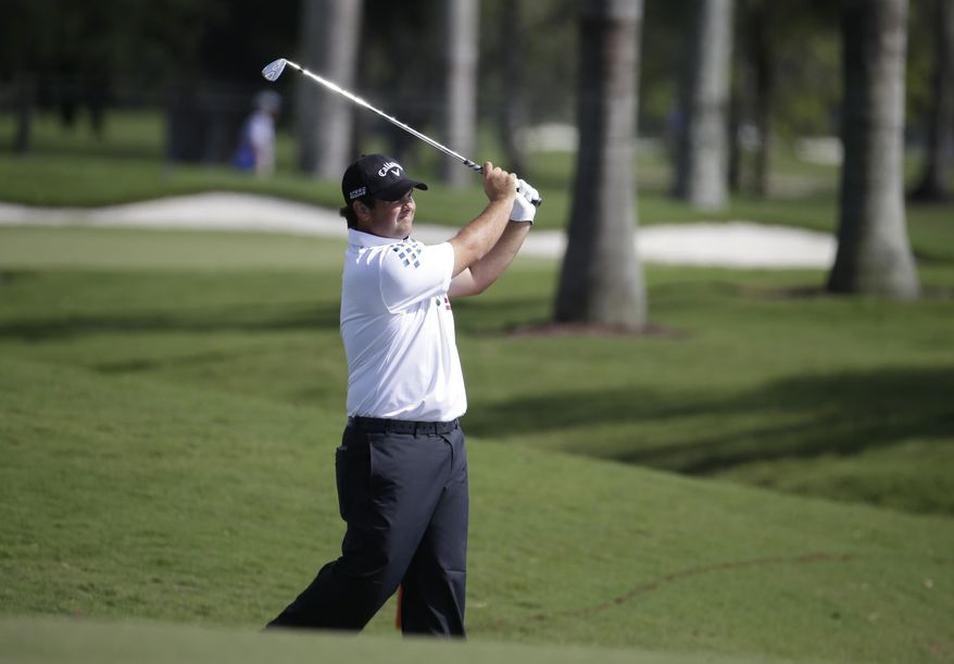 Patrick Reed hits from the eighth fairway during a continuation of the first round of the Cadillac Championship golf tournament, Friday, March 7, 2014, in Doral, Fla. Play was suspended before the end of play Thursday due to severe weather. (AP Photo/Lynne Sladky)