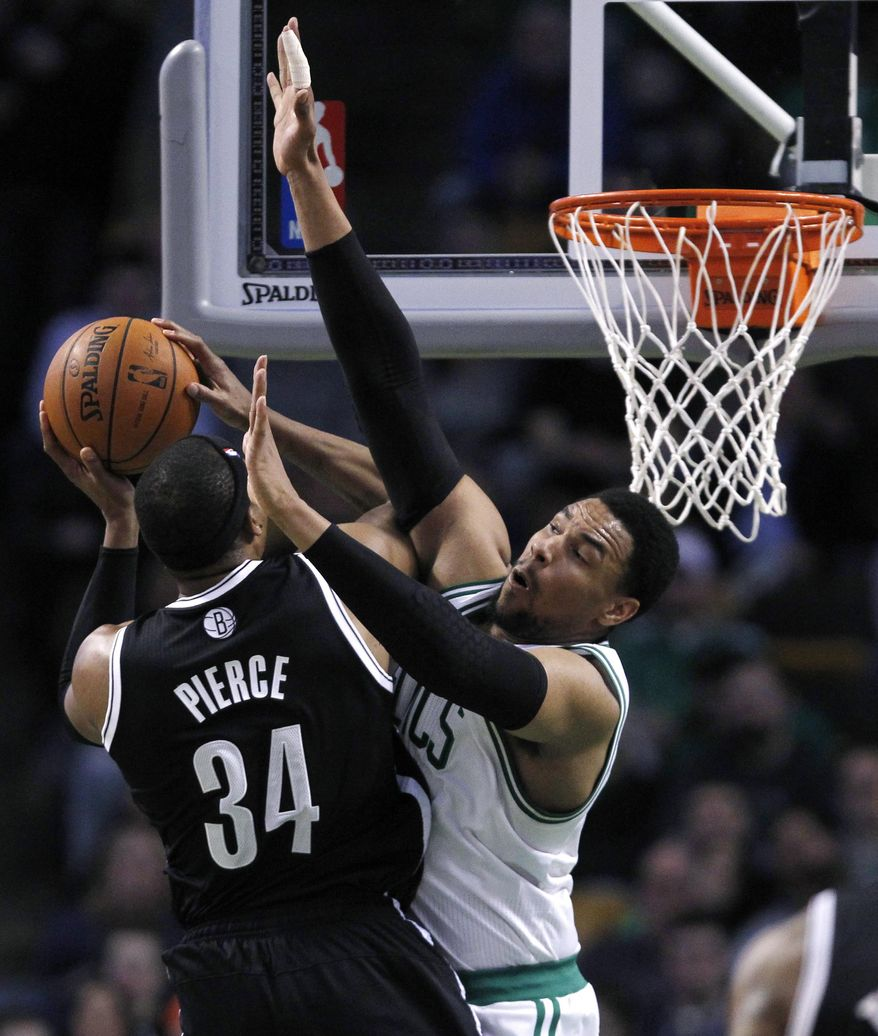 Boston Celtics center Jared Sullinger, right, defends Brooklyn Nets forward Paul Pierce (34) on a drive to the basket during the second quarter of an NBA basketball game, Friday, March 7, 2014, in Boston. (AP Photo/Charles Krupa)