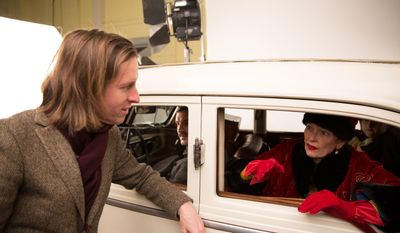 """This image released by Fox Searchlight shows director Wes Anderson, left, with Tilda Swinton on the set of """"The Grand Budapest Hotel ."""" (AP Photo/Fox Searchlight, Martin Scali)"""