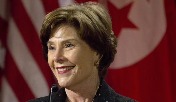 Former first lady Laura Bush speaks during George W. Bush Institute's fellowship program on International Women's Day at the George W. Bush Presidential Center, March 7, 2014, in Dallas. (AP Photo/The Dallas Morning News, Sarah Hoffman) ** FILE **