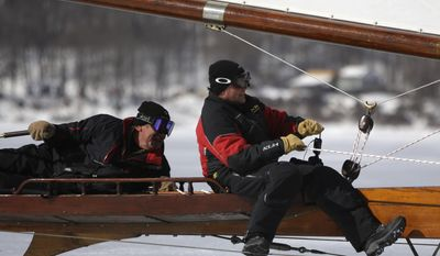 Richard Lawrence, left, of Newburgh, N.Y., pilots the ice boat Jack Frost with his son Kevin Lawrence on the Hudson River on Saturday, March 1, 2014, in Barrytown, N.Y. (AP Photo/Mike Groll)