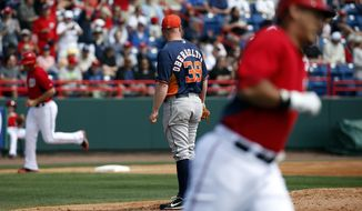 Houston Astros starting pitcher Brett Oberholtzer (39) watches as members of the Washington Nationals round the bases during Wilson Ramos' three-run homer in the first inning of a spring exhibition baseball game, Friday, March 7, 2014, in Viera, Fla. (AP Photo/Alex Brandon)