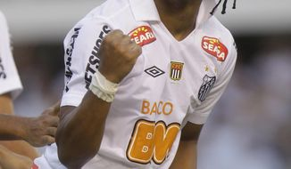 "FILE - In this May 15, 2011 file photo, Santos' Arouca celebrates after scoring against Corinthians, during their Sao Paulo league soccer final match, in Santos, Brazil.  Arouca, who played for Brazil's national team last year, was on the field talking to reporters after his team's 5-2 win in the Sao Paulo state championship on Thursday when some fans in the stands called him ""monkey."" (AP Photo/Andre Penner, File)"