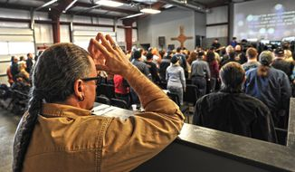 "JD Tew, pastor at the Freedom Biker Church, listens to the band   ""When Forever Comes,""  before he speaks Sunday, Feb. 16, 2014. (AP Photo/The Fayetteville Observer, Cindy Burnham.)"