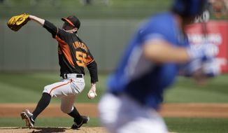 San Francisco Giants' Tim Lincecum pitches to the Kansas City Royals in the second inning of a spring training baseball game, Friday, March 7, 2014, in Surprise, Ariz. (AP Photo/Tony Gutierrez)