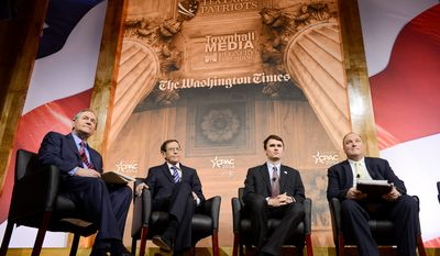 The Washington Times Newspaper Editor John Solomon, right, introduces a panel including Former Gov. of Virginia and Free Congress Foundation President & Chief Executive Officer Jim Gilmore, Jr., left, Bruce Fein & Associates, Inc. Principle Bruce Fein, second from left, and TurningPoint USA Director Charlie Kirk, second from right, on the death of american privacy at the Conservative Political Action Conference (CPAC) held at the Gaylord Hotel, National Harbor, Md., Friday, March 7, 2014. (Andrew Harnik/The Washington Times)