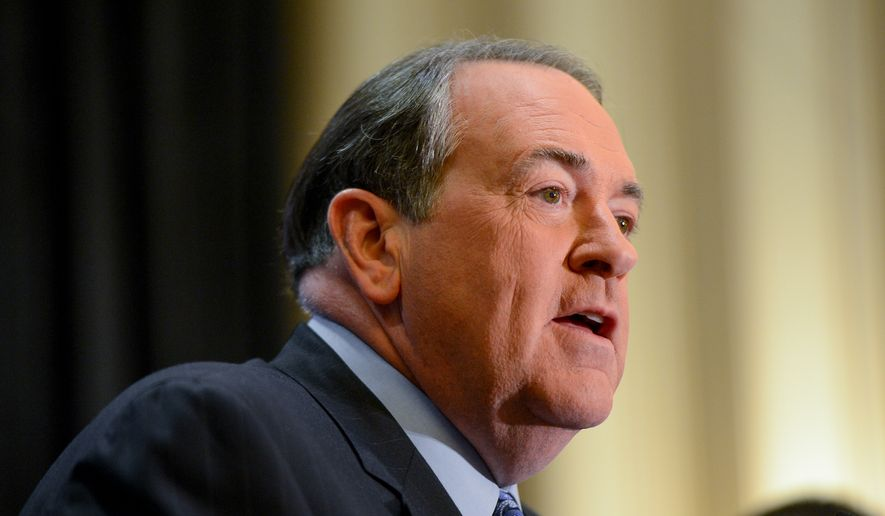 ** FILE ** Former Arkansas Gov. Mike Huckabee speaks at the Conservative Political Action Conference (CPAC) held at the Gaylord Hotel, National Harbor, Md., Friday, March 7, 2014. (Andrew Harnik/The Washington Times)