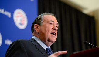 Former Arkansas Gov. Mike Huckabee speaks at the Conservative Political Action Conference (CPAC) at the Gaylord Hotel in National Harbor, Md., on March 7, 2014. (Andrew Harnik/The Washington Times)