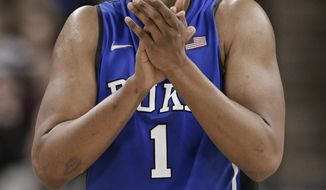 Duke's Jabari Parker reacts after being called for his fourth foul, during the second half of an NCAA college basketball game against Wake Forest in Winston-Salem, N.C., Wednesday, March 5, 2014. Wake Forest won 82-72. (AP Photo/Chuck Burton)