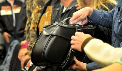 Bike saddle bags are passed around for the offering at the Freedom Biker Church Sunday, Feb. 16, 2014. (AP Photo/The Fayetteville Observer, Cindy Burnham.)