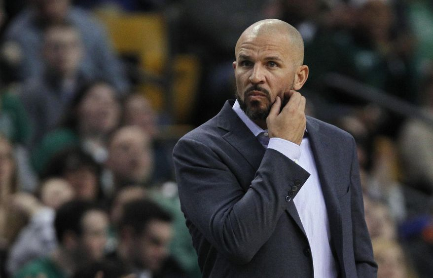 Brooklyn Nets coach Jason Kidd scratches his beard during the first quarter of an NBA basketball game against the Boston Celtics, Friday, March 7, 2014, in Boston. (AP Photo/Charles Krupa)