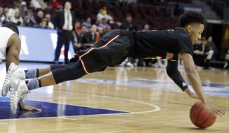 Santa Clara's Brandon Clark dives for a loose ball during the first half of a West Coast Conference tournament NCAA college basketball game against Pacific on Thursday, March 6, 2014, in Las Vegas. (AP Photo/Isaac Brekken)