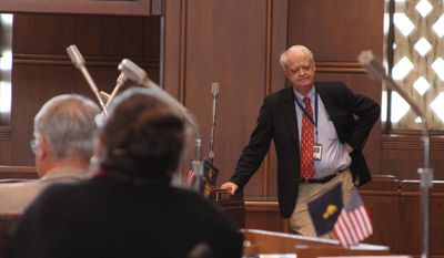 Senate President Peter Courtney, D-Salem, stands on the Senate floor on Thursday, March 6, 2014 at the state Capitol in Salem, Ore. The Oregon Legislature is pushing to adjourn as soon as Friday. (AP Photo/Chad Garland)