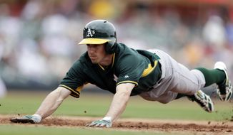Oakland Athletics' Billy Burns dives back safely to first base while pinch running for Nick Punto during the sixth inning of an exhibition spring training baseball game against the Arizona Diamondbacks, Thursday, March 6, 2014, in Scottsdale, Ariz. (AP Photo/Gregory Bull)