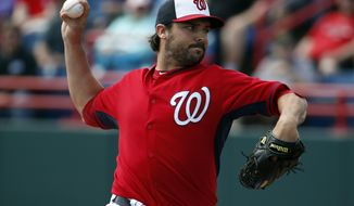 Washington Nationals pitcher Tanner Roark throws in the first inning of a spring exhibition baseball game against the Houston Astros, Friday, March 7, 2014, in Viera, Fla. (AP Photo/Alex Brandon)