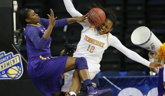 LSU forward Shanece McKinney (21) blocks Tennessee forward Bashaara Graves' shot during the first half in an NCAA college basketball game in the quarterfinals of the Southeastern Conference women's tournament, Friday, March 7, 2014, in Duluth, Ga. (AP Photo/John Bazemore)