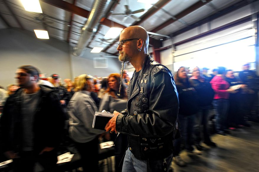 Bill Johnson, associate pastor at the Freedom Biker Church, walks toward the stage Sunday, Feb. 16, 2014. (AP Photo/The Fayetteville Observer, Cindy Burnham.)