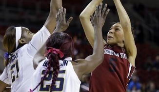 Washington State's Tia Presley, right, puts up a shot in front of California's Gennifer Brandon (25) and Reshanda Gray in the first half of an NCAA college basketball game in the Pac-12 women's tournament  Friday, March 7, 2014, in Seattle. (AP Photo/Elaine Thompson)