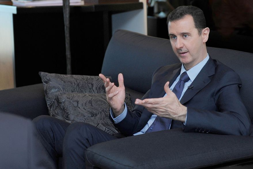 ** FILE ** In this Monday, Aug. 26, 2013, file photo released by the Syrian official news agency SANA, Syrian President Bashar Assad gestures as he speaks during an interview with a Russian newspaper in Damascus, Syria. (AP Photo/SANA, File)