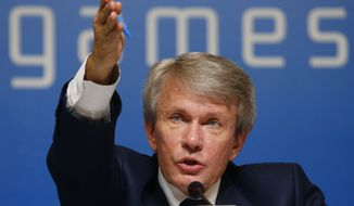 President of the the National Paralympic Committee of Ukraine Valeriy Suskevich gestures as he answers a question during a press conference before the opening ceremony of the 2014 Winter Paralympics in Sochi, Russia, Friday, March 7, 2014. (AP Photo/Pavel Golovkin)