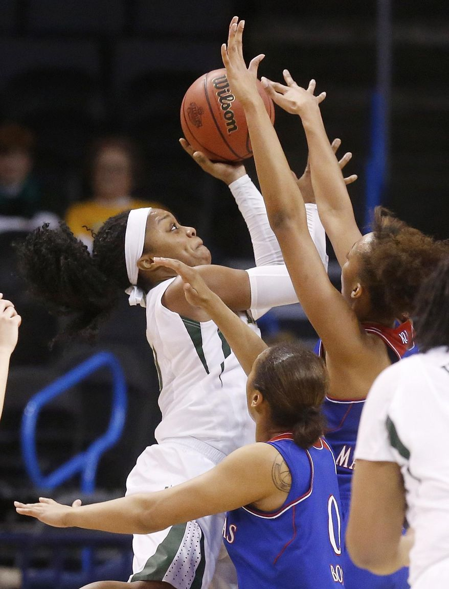 Baylor guard Odyssey Sims (0) shoots in front of Kansas guard Asia Boyd (0) and forward Caelynn Manning-Allen (25) in the first half of an NCAA college basketball game in the quarterfinals of the Big 12 Conference women's basketball tournament in Oklahoma City, Saturday, March 8, 2014. (AP Photo/Sue Ogrocki)