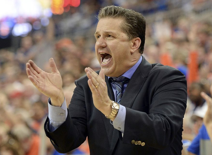 Kentucky coach John Calipari cheers his team on during the second half of an NCAA college basketball game against Florida  Saturday, March 8, 2014, in Gainesville, Fla.  Florida defeated Kentucky 84-65. (AP Photo/Phil Sandlin)