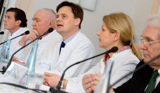 The team of doctors involved in treating Yulia Tymoshenko, from left,  Peter Vajkoczy,  Norbert Haas, Matthias Endres, Anett Reisshauer and Karl Max Einhaeupl  attend  a press conference at Charite Hospital in Berlin, Germany,  Saturday March 8, 2014.  Ukraine's former prime minister, Yulia Tymoshenko, has started medical treatment at Berlin's Charite hospital after arriving late Friday, but doctors treating her say it's too soon to say how long this will take. Hospital chairman Karl Max Einhaeupl says doctors will decide by Monday whether the 53-year-old needs an operation for her severe back pain resulting from slipped discs she suffered more than two years ago.  (AP Photo/dpa,Kay Nietfeld)