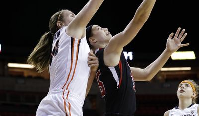 Oregon State's Ruth Hamblin, left, blocks a spinning shot attempt by Utahs's Michelle Plouffe in the first half of an NCAA college basketball game in the Pac-12 women's tournament Friday, March 7, 2014, in Seattle. (AP Photo/Elaine Thompson)