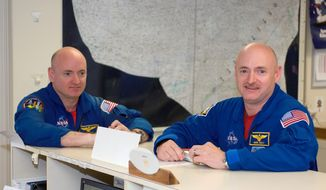 This undated photo provided by NASA,  astronauts Mark Kelly, right, STS-124 commander, and Scott Kelly are pictured in the check-out facility at Ellington Field near NASA's Johnson Space Center in Houston.   NASA announced Friday, March 7, 2014,  that Mark Kelly and astronaut Scott Kelly will participate in 10 different investigations. Craig Kundrot, deputy chief scientist of NASA's Human Research Program, says in a news release that the brothers provide a unique opportunity to study two people with the same genetics who were in different environments. Officials say Scott Kelly spent a year in space while Mark Kelly was on Earth. NASA says it is hoping the studies can be the basis for future research initiatives.  (AP Photo/NASA)