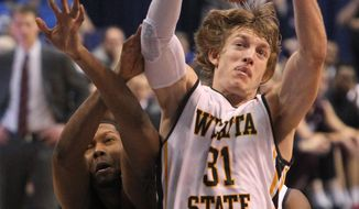 Wichita State guard Ron Baker (31) pulls down a rebound against Missouri State forward Gavin Thurman during the first half of an NCAA college basketball game in the semifinals of the Missouri Valley Conference men's tournament Saturday, March 8, 2014, at the Scottrade Center in St. Louis.  (AP Photo/St. Louis Post-Dispatch, Chris Lee)  EDWARDSVILLE INTELLIGENCER OUT; THE ALTON TELEGRAPH OUT