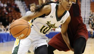 South Florida's Courtney Williams, left, drives around Temple's Monaye Merritt, right, during the first half of an NCAA college basketball game in the quarterfinals of the American Athletic Conference women's basketball tournament, Saturday, March 8, 2014, in Uncasville, Conn. (AP Photo/Jessica Hill)
