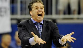 Kentucky coach John Calipari reacts to a play during an NCAA college basketball game against Florida Saturday, March 8, 2014, in Gainesville, Fla.  Florida won the game 84-65. (AP Photo/Phil Sandlin)