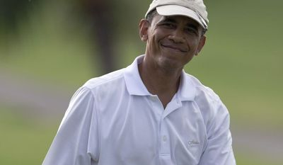 ** FILE ** President Obama smiles as he walks from 18th green at Mid-Pacific County Club in Kailua, Hawaii, Wednesday, Jan. 1, 2014.  (AP Photo/Carolyn Kaster)