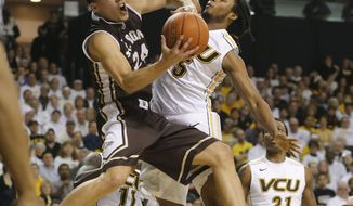 Bonnie's Matthew Wright (24)  is stopped by VCU's Doug Brooks (5) during an NCAA college basketball game, Saturday, March 8, 2014 in Richmond, Va. (AP Photo/Richmond Times-Dispatch, Joe Mahoney)