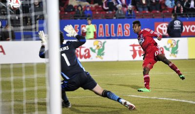 FC Dallas' Kellyn Acosta shoots on goal against Montreal Impact keeper Troy Perkins during an MLS soccer game Saturday, March 8, 2014, in Frisco, Texas. (AP Photo/The Dallas Morning News, Matthew Busch) MANDATORY CREDIT; MAGS OUT; TV OUT; INTERNET USE BY AP MEMBERS ONLY; NO SALES