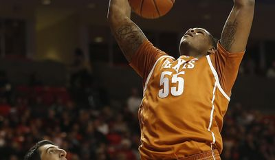 Texas' Cameron Ridley dunks over Texas Tech's Dejan Kravic during their NCAA college basketball game in Lubbock, Texas, Saturday, Mar, 8, 2014. (AP Photo/Lubbock Avalanche-Journal, Zach Long) ALL LOCAL TV OUT