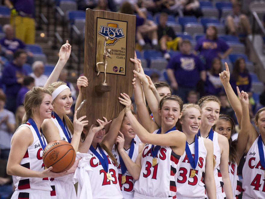 Oregon-Davis High School players celebrate with their trophy after winning the IHSAA Girls Basketball Class A Championships, March 8, 2014, in Terre Haute, Ind. Oregon-Davis defeated Vincennes Rivet 69-64. (AP Photo/Doug McSchooler)