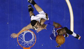 Philadelphia 76ers' Tony Wroten, right, goes up to shoot against -Utah Jazz's Enes Kanter during the first half of an NBA basketball game on Saturday, March 8, 2014, in Philadelphia. (AP Photo/Matt Slocum)
