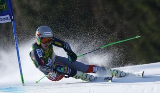 Ted Ligety of United States competes during the first run of an alpine ski men's World Cup giant slalom,  in Kranjska Gora, Slovenia, Saturday, March 8, 2014. (AP Photo/Shinichiro Tanaka)
