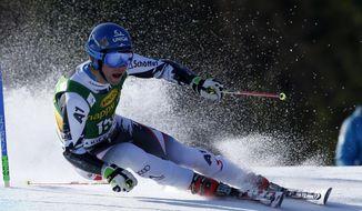 Benjamin Raich of Austria competes during the first run of an alpine ski men's World Cup giant slalom,  in Kranjska Gora, Slovenia, Saturday, March 8, 2014. (AP Photo/Shinichiro Tanaka)
