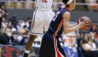 Tennessee-Martin guard Jasmine Newsome (12) defends against Belmont's Jordyn Luffman (13) in the first half of an NCAA college basketball game in the championship of the Ohio Valley Conference women's basketball tournament on Saturday, March 8, 2014, in Nashville, Tenn. (AP Photo/Mark Humphrey)