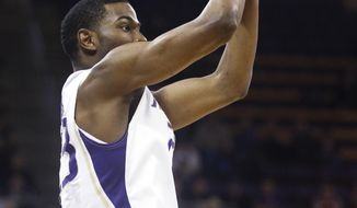 Washington guard C.J. Wilcox (23) shoots a 3-pointer against Southern California during the first half of an NCAA college basketball game, Saturday, March 8, 2014, in Seattle. (AP Photo/Joe Nicholson)