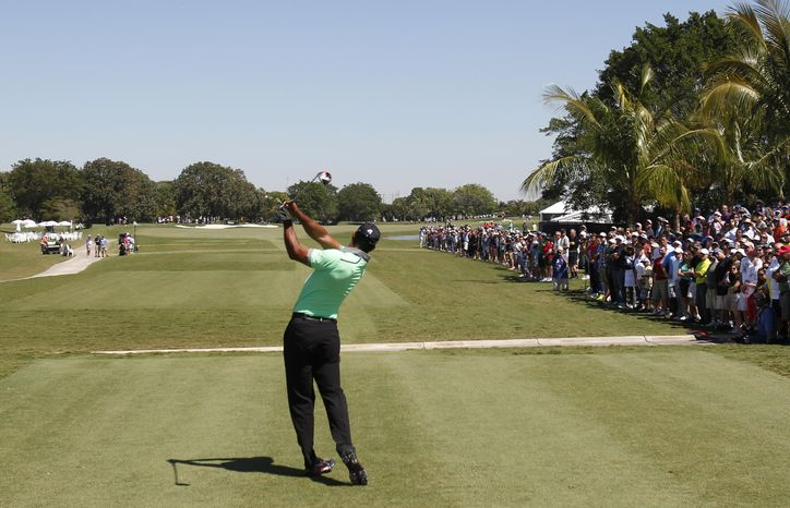 Tiger Woods hits from the third tee during the third round of the Cadillac Championship golf tournament Saturday, March 8, 2014, in Doral, Fla. (AP Photo/Wilfredo Lee)